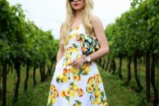 With lemon printed clutch and sunglasses