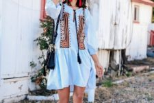 With light blue mini dress and black bag