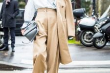 With loose shirt, gray bag, light brown midi coat and beige shoes