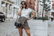With loose t-shirt, chain strap bag and cutout boots
