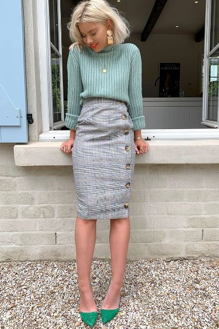 With mint sweater and green pumps