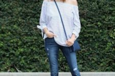 With off the shoulder blouse, hat, skinny jeans and crossbody bag