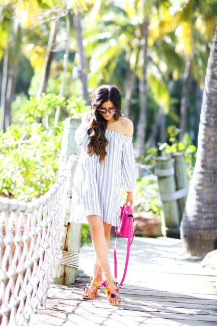 With off the shoulder dress and pink bag