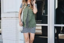 With olive green vest, white bag and gray suede boots