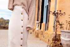 With pale pink oversized sweatshirt and high heels