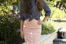 With pale pink pencil knee-length skirt