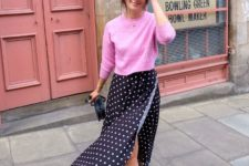 With pink shirt, mini bag and black flat mules