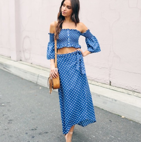 With polka dot off the shoulder top and brown bag