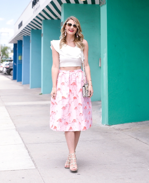 With printed A line skirt, mini bag and sandals