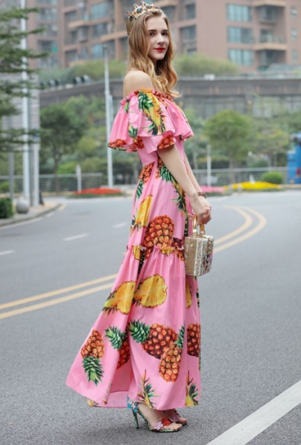 With printed sandals and embellished bag