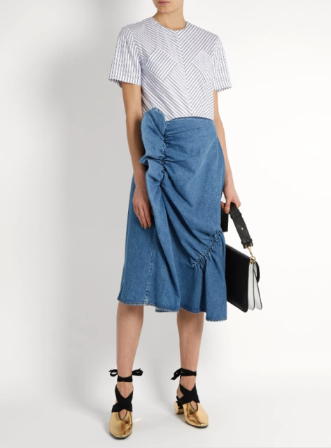 With printed shirt, white and black bag and golden lace up shoes