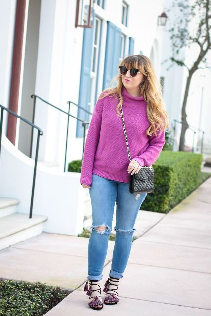 With purple sweater, cuffed jeans and black bag
