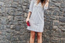 With red pumps and red clutch