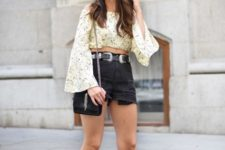 With shorts, black cap, chain strap bag and platform sandals