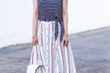 With striped midi skirt, white bag and red embellished shoes