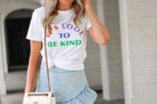 With t-shirt and white chain strap bag