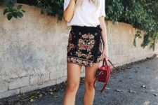 With t-shirt, red mini bag and white sneakers