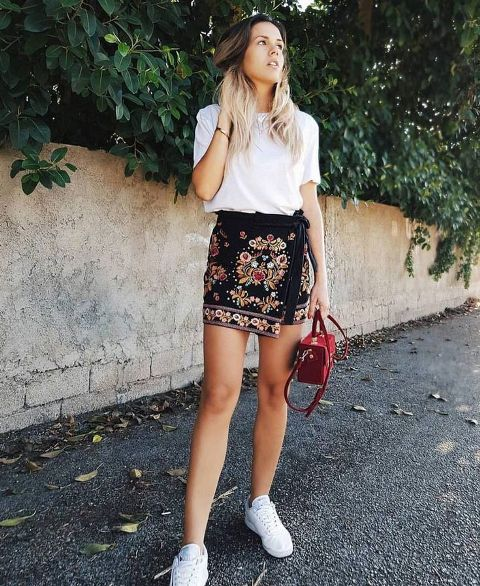With t shirt, red mini bag and white sneakers