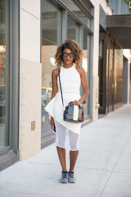 With white and black crossbody bag and sneakers