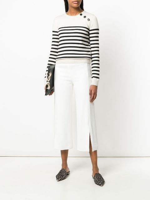 With white and black striped shirt, clutch and embellished flat mules