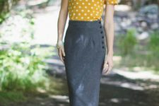 With white and yellow polka dot shirt and black ankle strap shoes