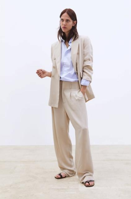 With white button down shirt, beige long blazer and black flat sandals