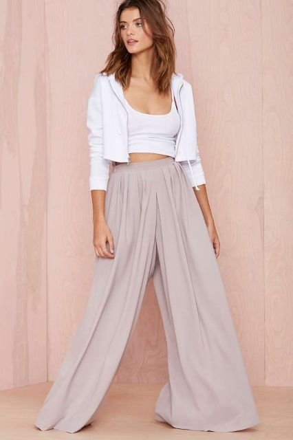 With white crop top, white crop jacket and shoes