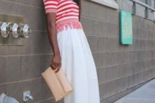 With white culottes, beige clutch and high heels