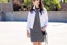 With white jacket, chain strap bag and lace up flats