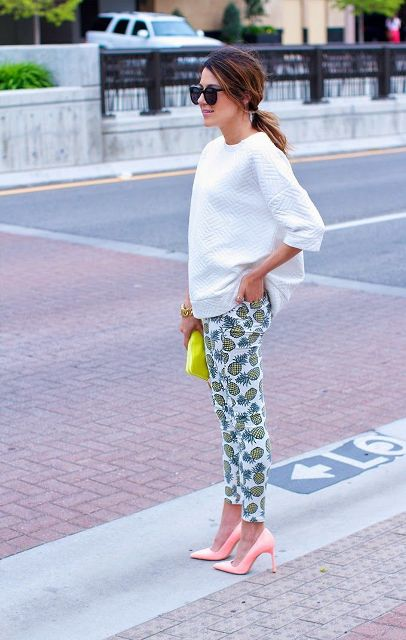 With white loose shirt, yellow clutch and pale pink pumps
