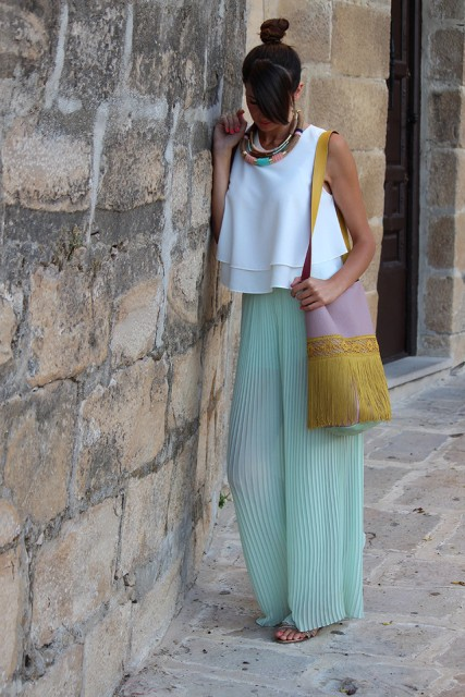 With white loose top, fringe bag and sandals