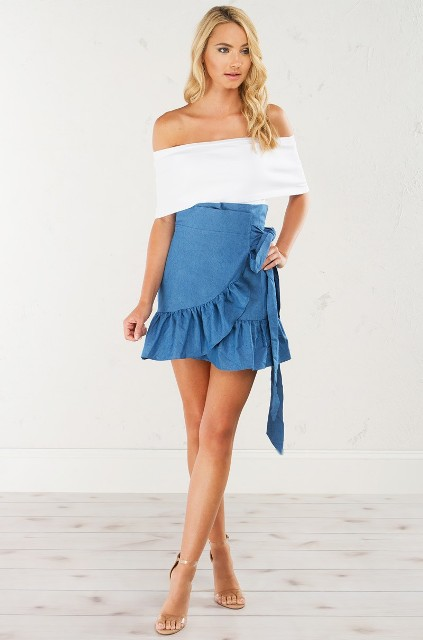 With white off the shoulder top and high heels