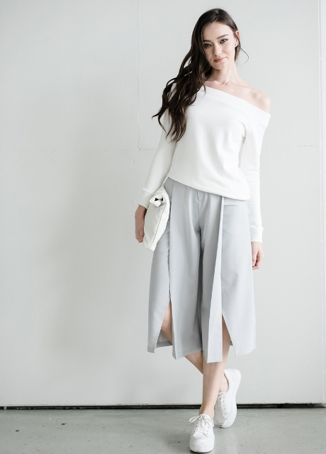 With white one shoulder shirt, white clutch and white sneakers