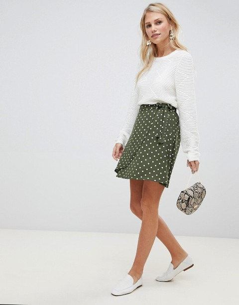 With white shirt, animal printed bag and white flats