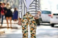 With white shirt, striped blazer, black bag and purple shoes