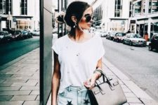 With white t-shirt and black bag