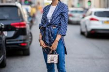 With white t-shirt, jeans, mini bag and high heels