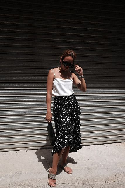 With white top, black clutch and flat sandals