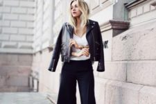 With white top, black leather jacket and black and white heels