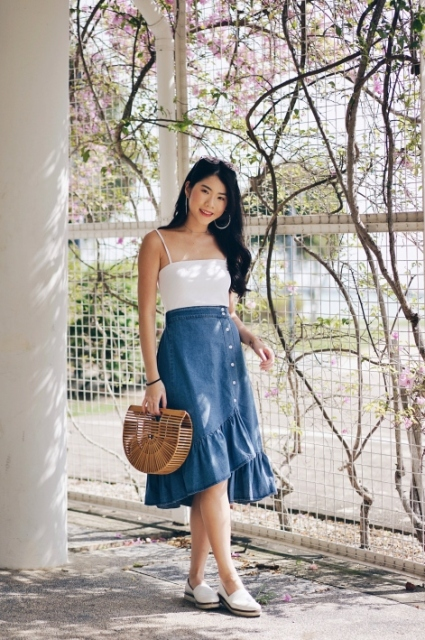 With white top, straw bag and white flat shoes