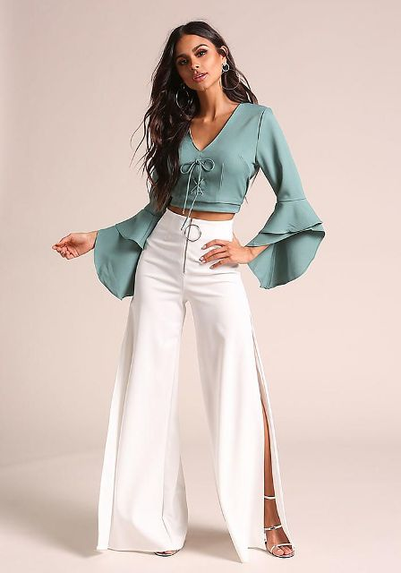 With white wide leg trousers and silver high heels