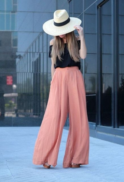 With wide brim hat, black off the shoulder top and platform shoes
