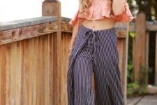 With wide brim hat, striped wide leg pants and heels