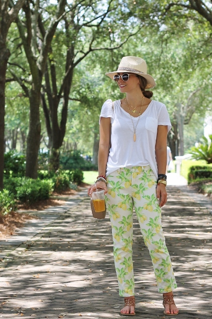 With wide brim hat, white loose t-shirt and flat sandals