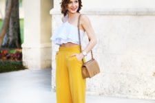With yellow culottes, beige bag and platform shoes