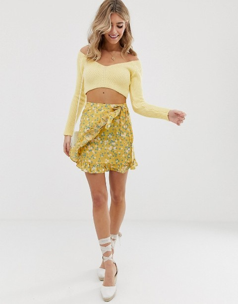 With yellow off the shoulder crop top and lace up flats