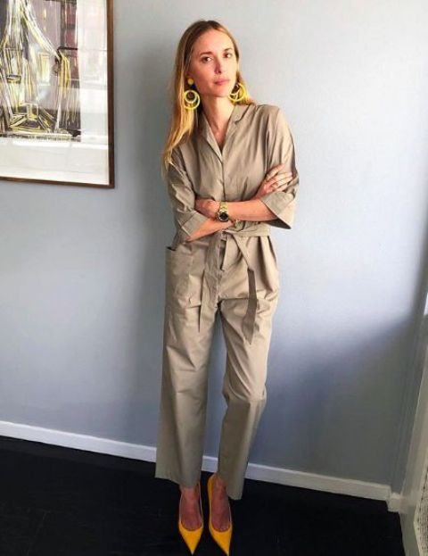 a beige boiler suit with large pockets, short sleeves, bright yellow shoes and statement earrings