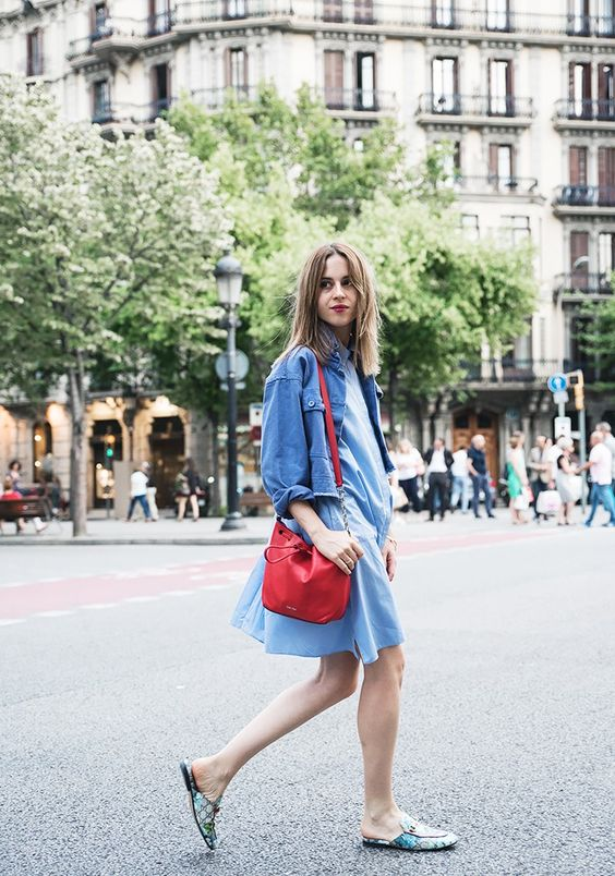 a blue knee dress, a black jacket, a red bag, printed slipper mules and a red lip for a catchy look