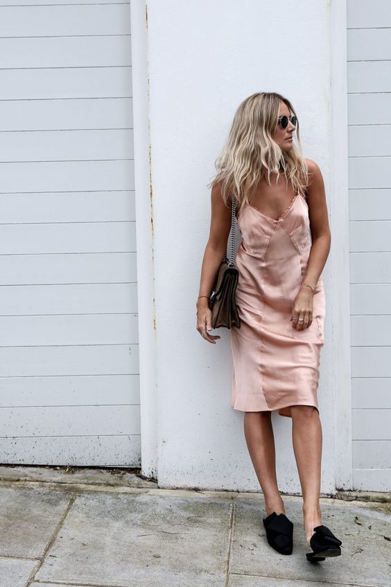 a blush silk slip dress, a brown bag and blakc slipper mules compose an eclectic look
