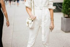 a comfy white denim boiler suit with a bel, teal mules and a small white bag for summer